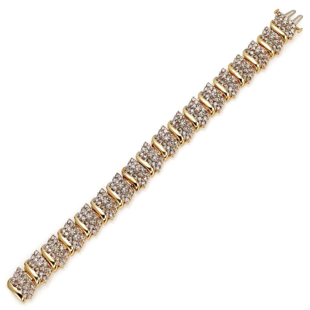 Bracciale in oro giallo e bianco 9kt con diamanti brown taglio brillante del peso di circa 10ct